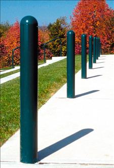 A row of seven 2190 Domed-top Metal Bollards